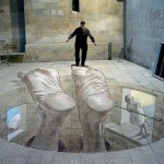 A visitor stands next to a 3D mural called, 'Insesatez', in Lleida, Spain. 3D graffiti by Argentinian artist Eduardo Relero
