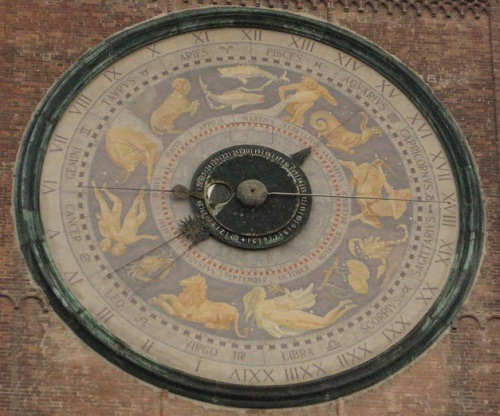 Facade Clocks on the Assumption of the Blessed Virgin Mary Roman Catholic cathedral in Cremona of Lombardy, northern Italy. Astronomical Clock