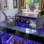 Relaxing blue color of a beautiful glass and light wine cellar by interior designer Jamie Beckwith