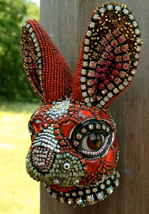 A hare head. Jewelry sculpture covered with mosaic of bead by American artist jeweler Betsy Youngquist