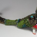 Judging by the tail, this is bird Lira. Jewelry sculpture covered with mosaic of bead by American artist jeweler Betsy Youngquist