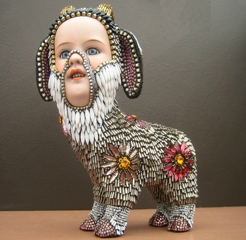 Lamb with a doll face. Jewelry sculpture covered with mosaic of bead by American artist jeweler Betsy Youngquist