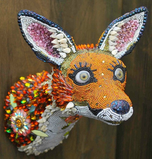 Looks like a fox. Jewelry sculpture by American artist jeweler Betsy Youngquist