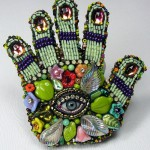 Hamsa – Jewish traditional hand decorated with a scattering of beads and rhinestones, with an eye in the center