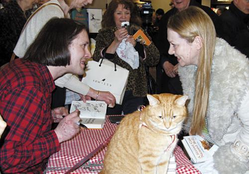 Bob stray cat and his owner James Bowen, London