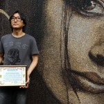 Proud Moscow based artist Arkady Kim with a document proving a new Guinness Book record