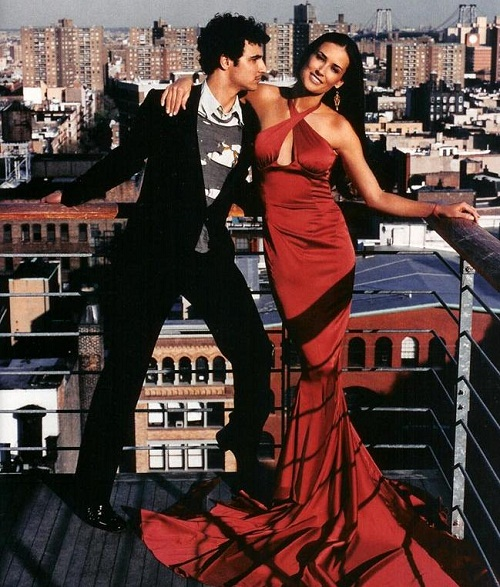 In a red dress. Demi Moore