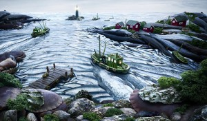 Fishscape - This coastal view is made out of of fish, along with lettuce leaves and a small boats transporting peas