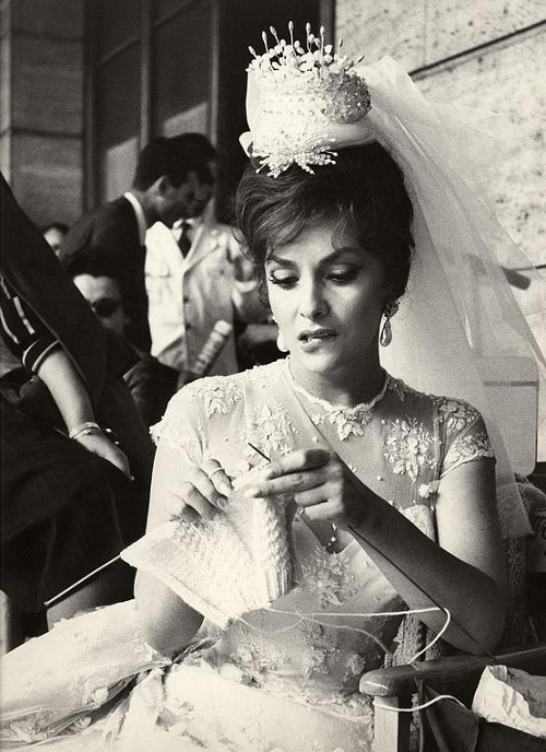Gina Lollobrigida is knitting