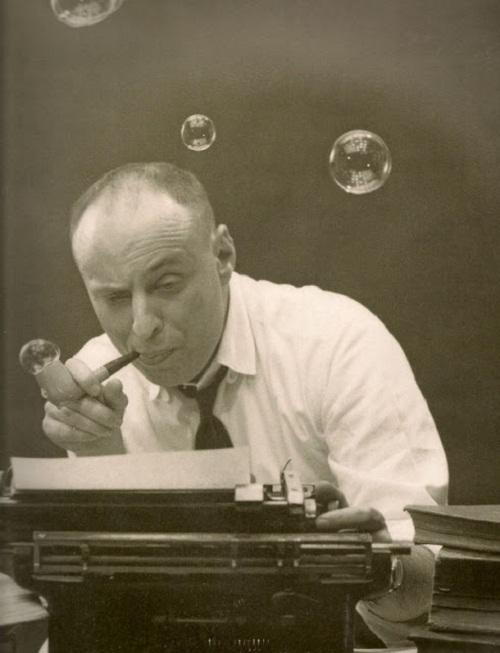 American cartoonist Harvey Kurtzman typing something on his type writer