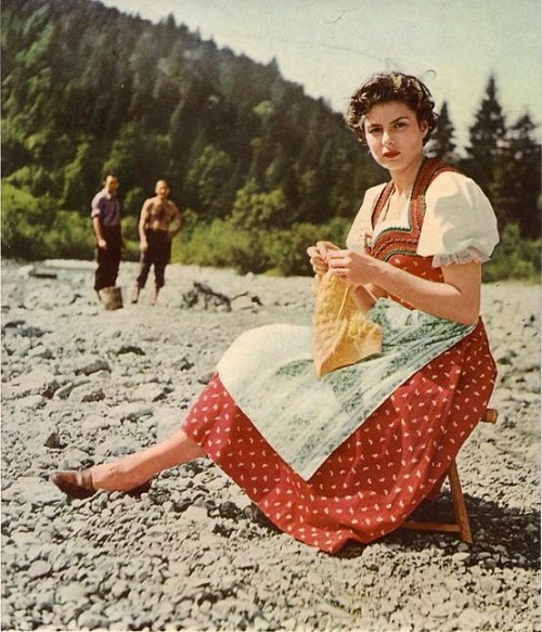 Swedish actress Ingrid Bergman, knitting on the beach