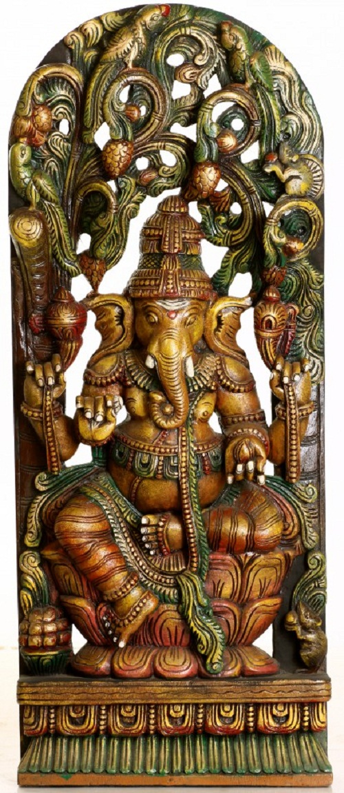 Lord Ganesha Seated in Lalitasana in the Backdrop of Floral Arch Aureole. South Indian Temple Wood Carving