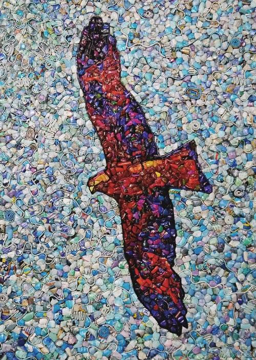 Flying eagle. Magazine mosaic by Russian artist Vasiliy Kolesnik