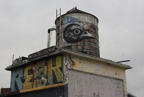 Very often faceless and gloomy constructions become a canvas for street artist Roa