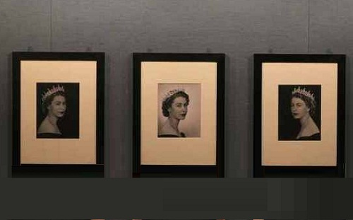 Photographs taken by Dorothy Wilding in 1952 of Queen Elizabeth II are hung as part of the exhibition The Queen: Portraits of a Monach being shown at Windsor Castle
