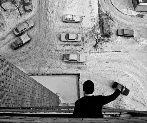 Playing cars from the balcony. Creative not photo shopped illusions