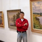 Russian artist Alexey Adamov at the exhibition of his paintings