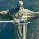 A helicopter in front of Statue of Jesus Christ in Rio de Janeiro looks like a toy