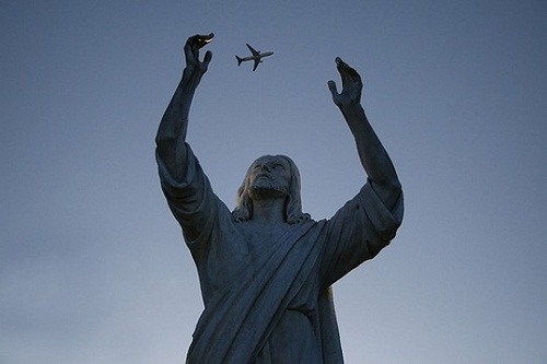 Statue of Jesus Christ in Rio de Janeiro and a flying plane