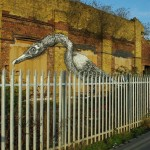 Behind the fence. Street art by Belgian graffiti artist Roa