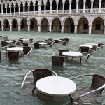 Street cafe furniture floating in Venice during a period of seasonal high water