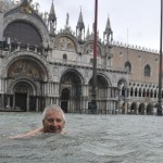 A man swimming in the street waters, Venice during a period of seasonal high water