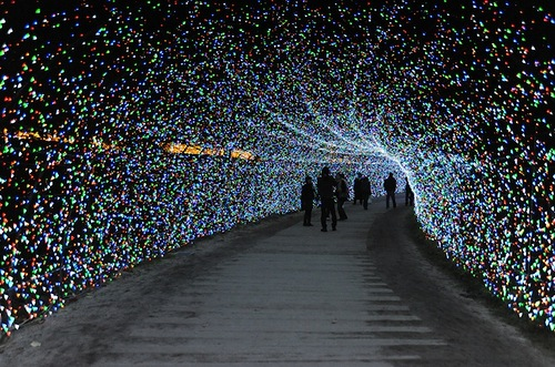 Walking through the tunnel. The world's largest light installation 'Winter light' in Japan