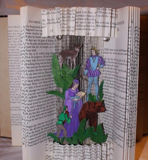 """Fairy Tale Book Sculpture"" LED lights illuminate three different fairy tale scenes."