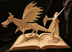 """""""Knight and Dragon"""". The book used is part of the Dragonlance series. Both dragon and knight are wired through the book for extra stability"""