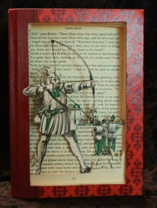 """""""Robin Hood"""" book sculpture. The book used is part of the """"Best Loved Books"""" series, published in the 60′s. Bow strings are made from wire."""
