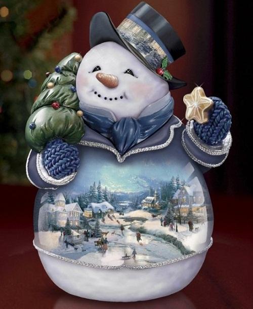 Christmas decorations by American artist Thomas Kinkade
