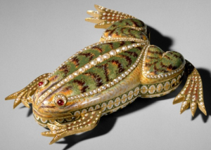 Automaton Frog, ca. 1820, Switzerland Gold and green enamel automaton in the form of a frog and set with pearls. Ruby eyes. Mechanism operates the legs to cause the frog to jump and croak.