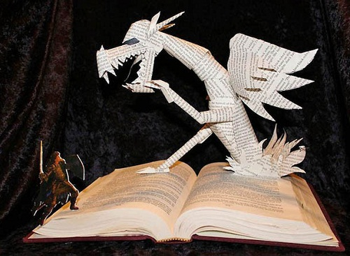 A dragon bursts through this book is flash of flames.