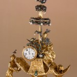 Automaton in the form of a chariot pushed by a Chinese attendant and set with a clock, 1766. Signed by James Cox