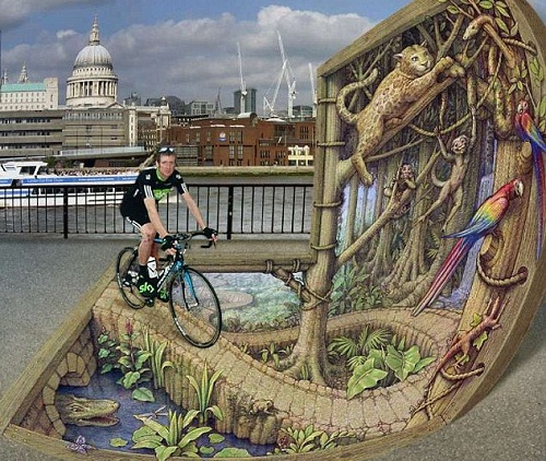 Bradley Wiggins gets involved in the artwork by riding along a jungle scene called St Paul's and London Craning Skyward