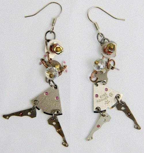 Funny girls in hats and short skirts dancing rumba. Earrings are mobile, every movement make them dance. Performed in a single copy, used machines clockword, watch parts, Japanese seed beads, crystals.