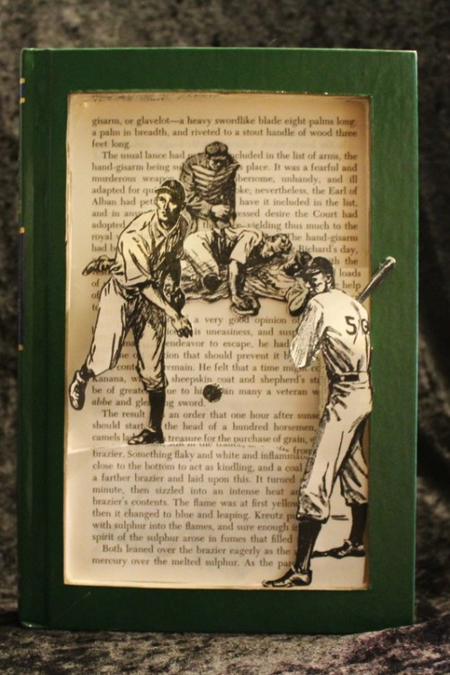 Keep your eye on the ball in this book sculpture!