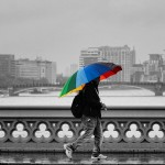 Rainbow umbrella against black and white background of London. Instagram competition