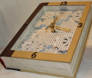 Make time to read. Working clock inside of book sculpture