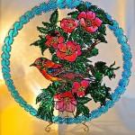 A bird in wild flowers bush. Decorative plates by Tatyana Zinkovskaya