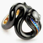 Sea snake ring made of gold with sapphires, covered with black enamel, House of Faberge
