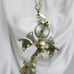Small pendant-style clockwork, figurine depicts a crow. In a product used watch parts - gears, components, Swarovski crystal beads, Japanese beads, watch rubies