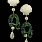 Vintage Chanel runway ear clips composed of resin scallop shells and green Lucite dolphins with iconic CC eyes grasping ball and tear drop faux pearls marked Chanel on back of clip