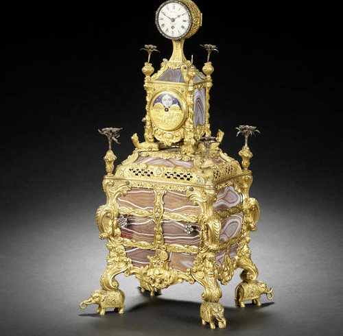 mid 18th century agate-paneled and silver-mounted musical ormolu table clock with moon-phase indication