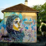 street artist C215 painted this stencil mural of his daughter, Nina in Montry, France