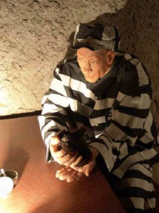 Life size wax figure of prisoner