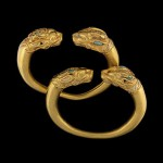 A pair of Turquoise and gold bracelet. They are separated by lion heads. Found in the burial ground No. 4 of Tillia-Tepe, age 1st century BC