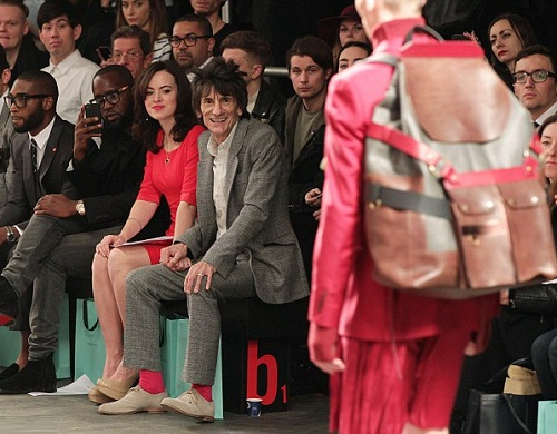 Jolly good show. Tinie Tempah (left) and Ronnie Wood and his wife Sally Humphreys pictured enjoying the colorful display