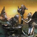 bronze sculpture of mermaids
