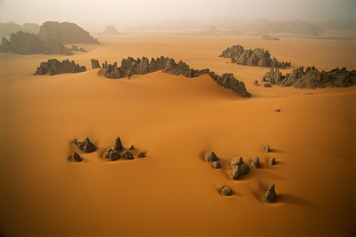 Tassili du Hoggar, Algeria. Beautiful natural rocky peaks sculptures formed under the influence of Central Sahara winds